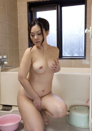 Shy lad hugs nude Japanese wife from behind touching one of her titties