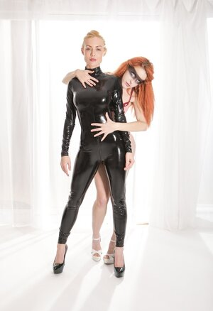 Red-haired broad in underwear shows appreciation towards blonde in latex