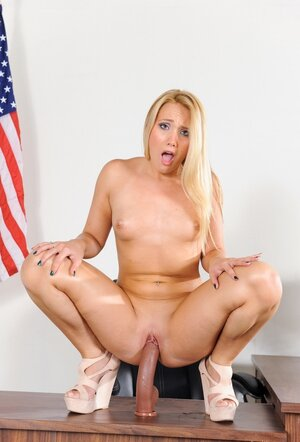 Shy blonde ready to nail her holes with gigantic sex toys on the working table