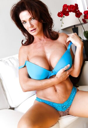 Aged goddess poses in blue lingerie that accentuates her fabulous assets