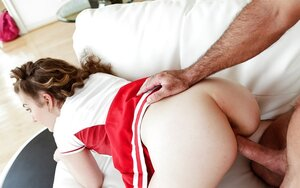 Curly-haired cheerleader lures vitiated coach into fantastic sex on sofa