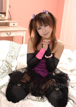 Innocent Japanese 18-19 y.o. in black tutu fools around in front of camera